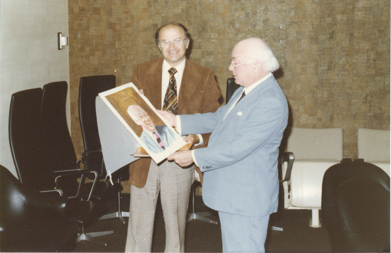 Photograph of Doug Eisner presenting a painting to Henry Hicks
