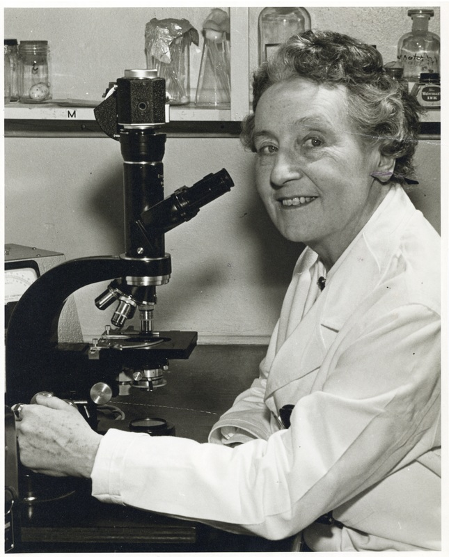 Photograph of Dixie Pelluet with microscope