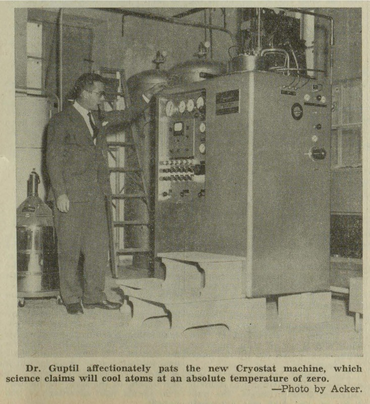 Photograph of Dr. Guptill with a Cryostat machine