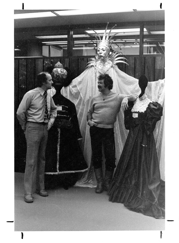 Photograph of Robert Doyle and Charles Armour with three costumes
