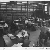 Photograph of people working in the law library in the Forrest Building