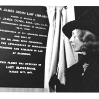 Photograph of Lady Beaverbrook with a plaque in honour of Sir James Dunn