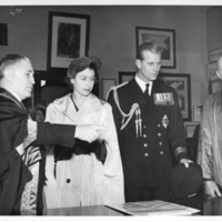 Photograph of Dr. Kerr, Princess Elizabeth, the Duke of Edinburgh, and Colonel Laurie