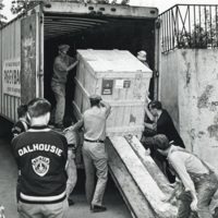 Photograph of men unloading a large crate at the Sir James Dunn Science Building
