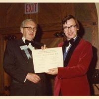 Photograph of Robert Jones receiving a certificate from the Canadian Psychiatric Association