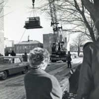 Photograph of a crane lifting a computer into the Sir James Dunn Science Building