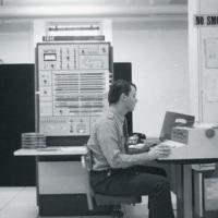 Photograph of man using a computer