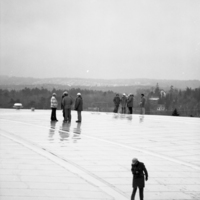 Photograph of men standing on the roof of the Dalplex
