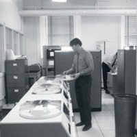 Photograph of two men in the Dalhousie Computer Centre at the University Club