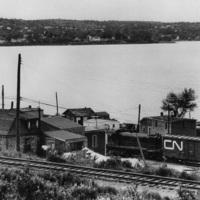 Photograph of a train running through Africville